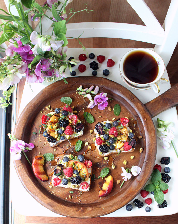 Sweet Berry & Grilled Peach Toasts with Crushed Pistachios, Honey, Mascarpone, & Mint