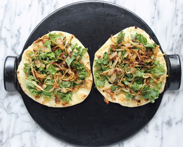 Kale & Butternut Squash Naan Pizzas w/ Cider Caramelized Onions, Aged Cheddar, & Sugared Pepitas