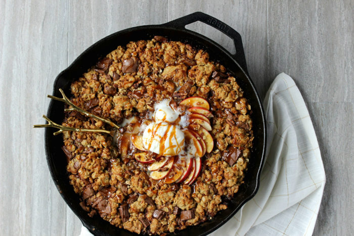 Apple Pie Oatmeal Chocolate Chunk Skillet Cookie w/ Caramel Drizzle